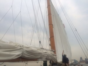 Members of the staff lifting the sails