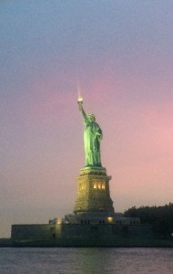 The Statue of Liberty shining with New York's sunset